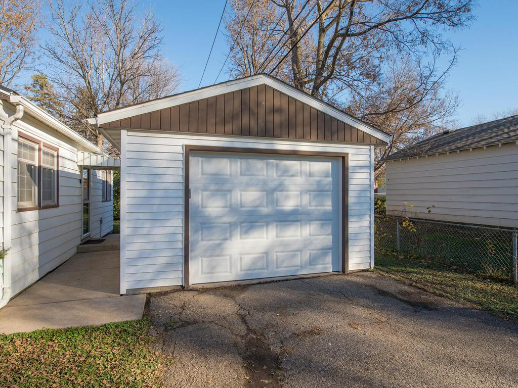 Detached garage is sheetrock and features keyless opener.