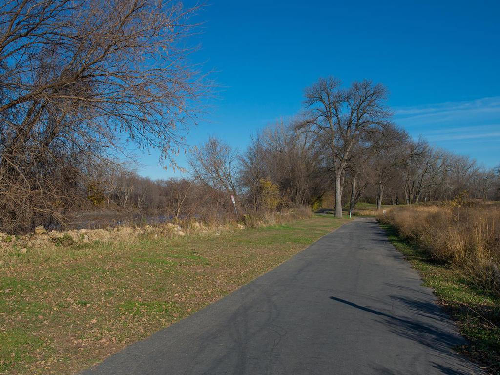 Bike trail access is along the river.  Just a 5 minute walk to access.
