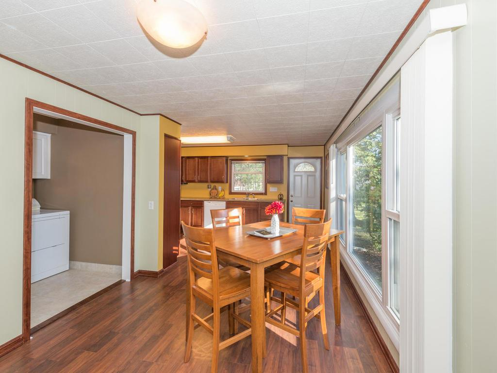 Sunny and spacious dining area with wood laminate flooring.
