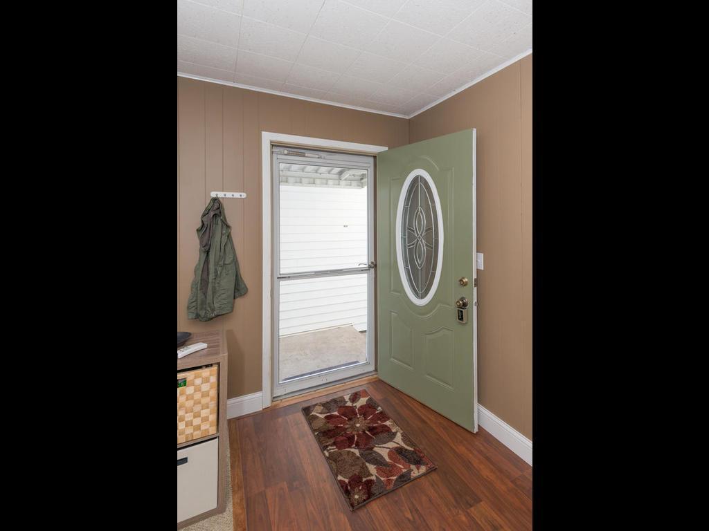 Foyer entry with laminate hardwood flooring.