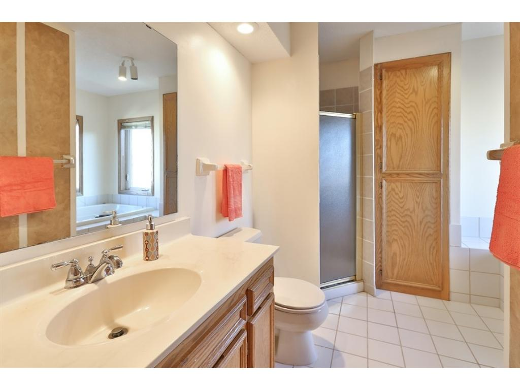 Private, ceramic master bath with separate shower and whirlpool tub.