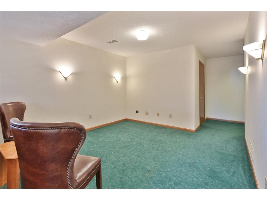 Lower level family room has enough space for a sectional sofa, large screen TV.  Prewired for speakers.