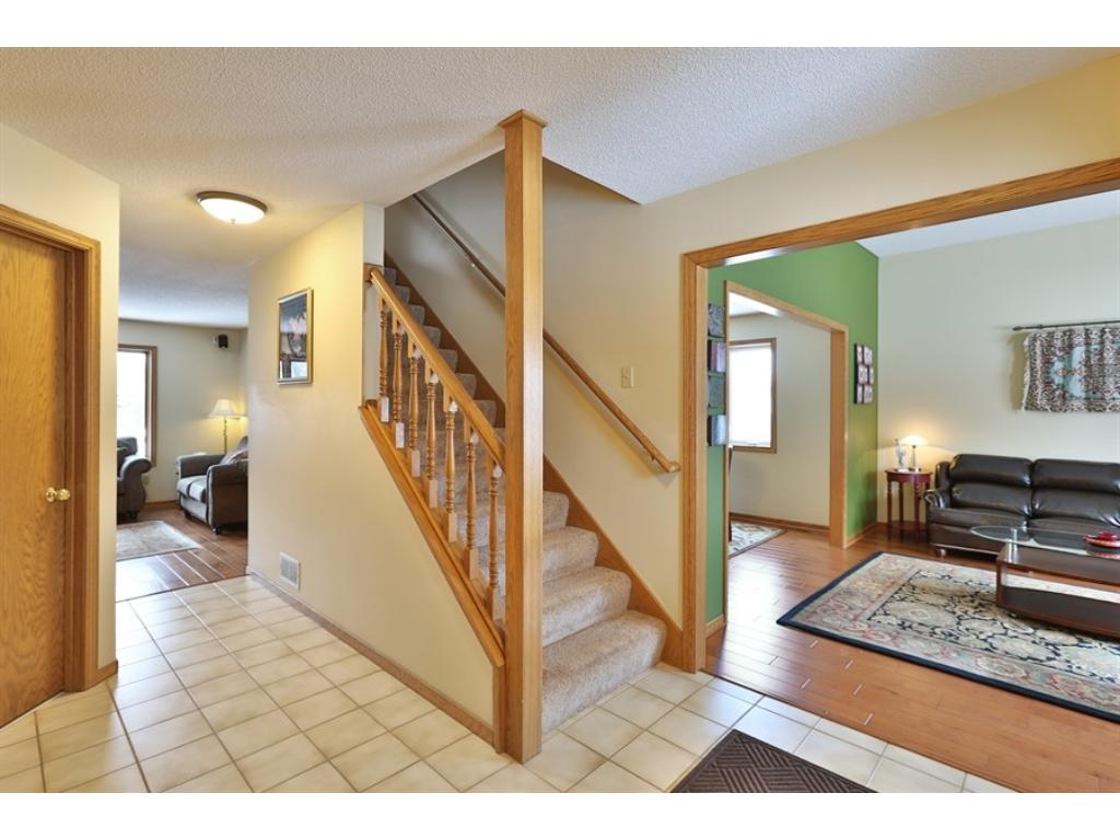 Very spacious ceramic tile foyer.  Open staircase, 1/2 bath located off the entrance as well as the garage entrance/laundry room.