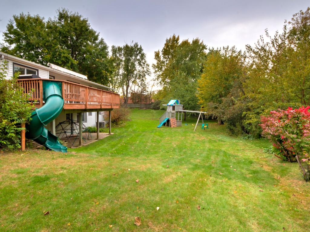 Large back yard with playset