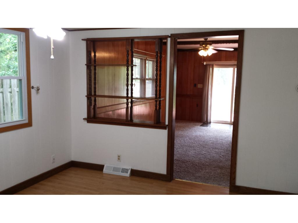 Dining room has views of the side yard gardens and wood floors