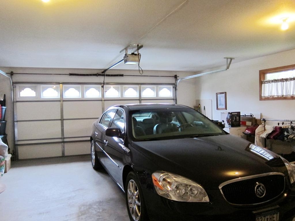 Large Double Garage with Large Extra Storage Room and Lock,  200 Amp Service, Gas Heater w/Thermostat, Sheetrocked Finished and Painted, Garage Door Opener,