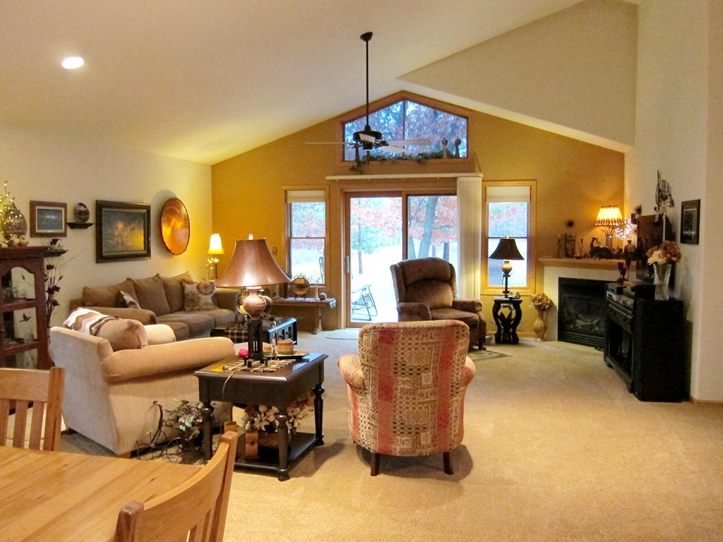 Vaulted Ceilings, Great Architectural Design, leads out to a Large Patio with a Motorized, Remote Controlled 'Creative Living Concepts Retractable Awning' to enjoy the Private Wooded Back Yard in Any Weather! Handicap Accessible throughout!
