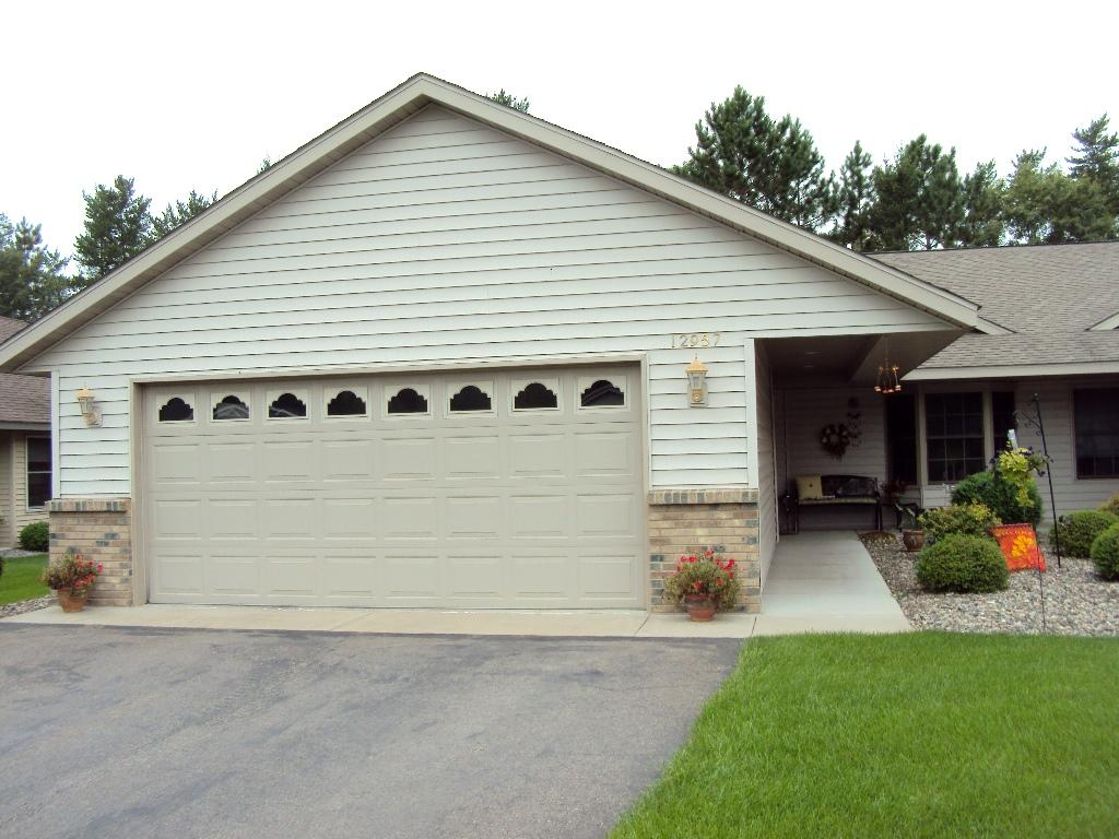 Front of Home with Covered Walkway & Beautiful Courtyard Entry.