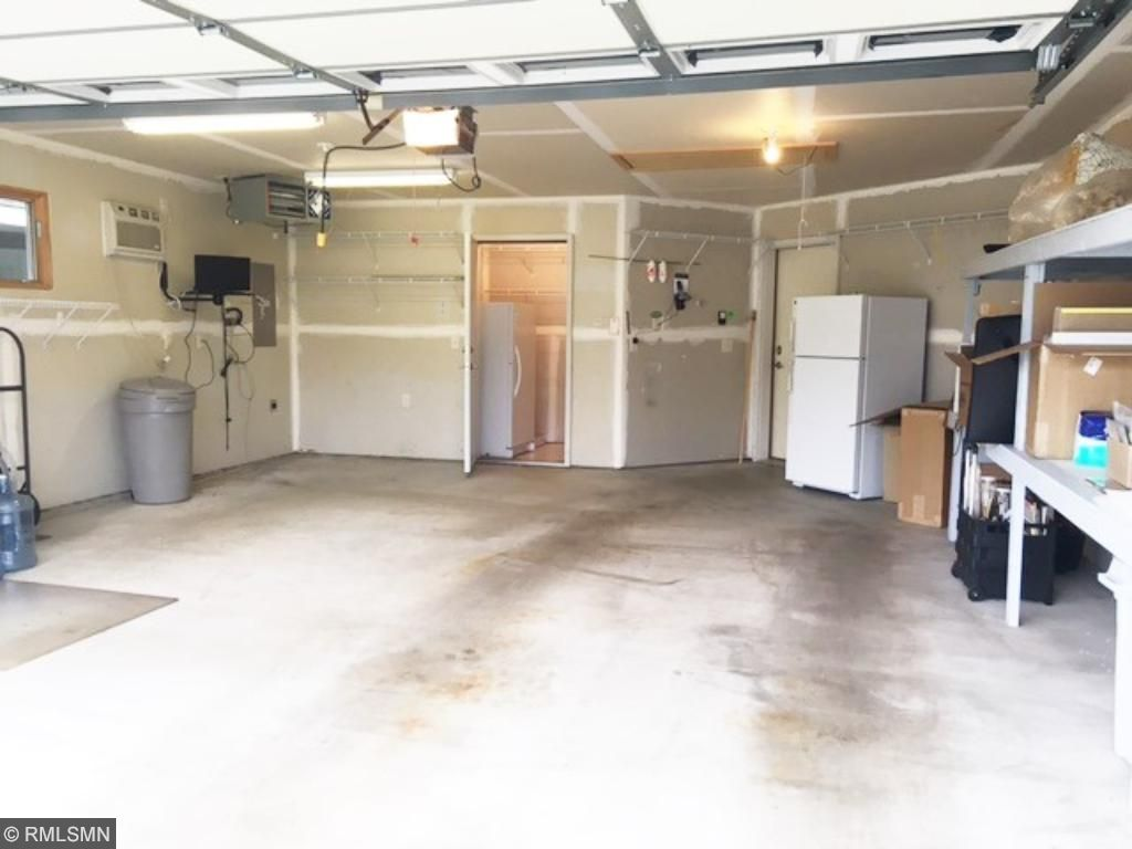 Heated, insulated, A/C & wired for tv in garage. See the storage room? Great extra storage. The fridge & freezer in garage are NOT included in the sale.