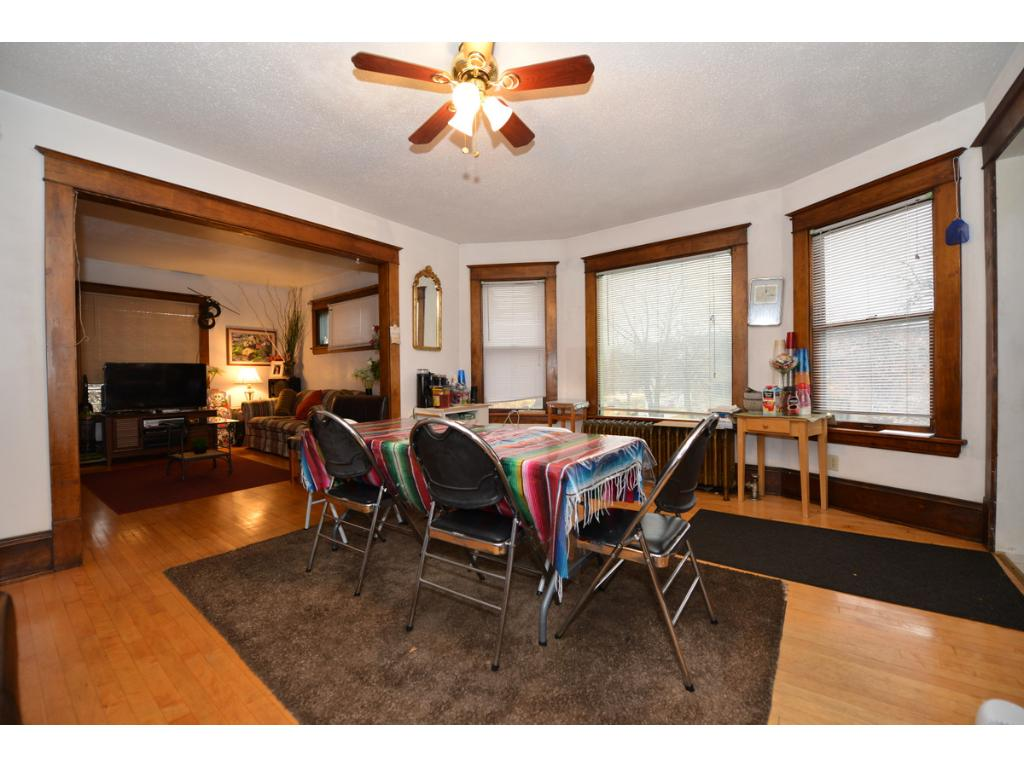 Lovely 2nd floor unit, long term tenants.  Hardwood floors redone a few years ago. -- Probably the same potential on main floor.