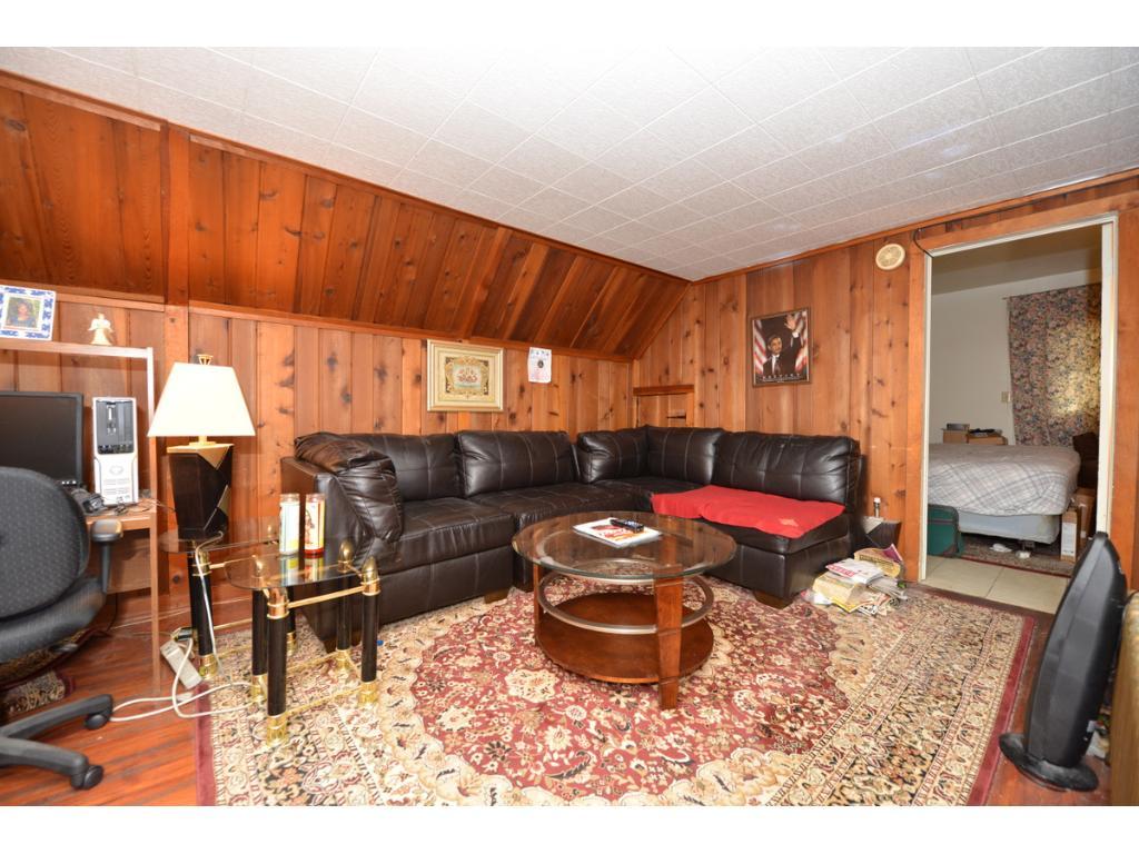 Third floor, 3rd unit living room -- cozy wood.