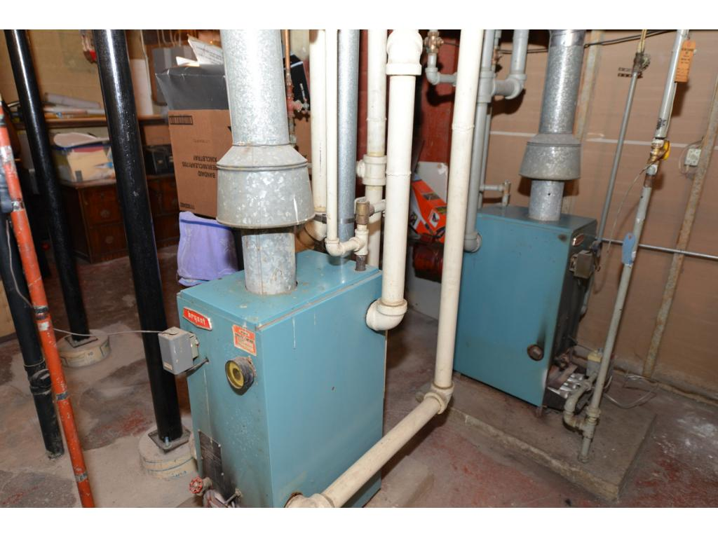Two hot water boilers, one for first & third floor; one for 2nd floor.  Newer water heater.