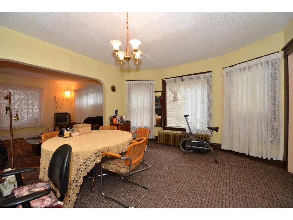 Nice dining room, most likely has original hardwood floor -- see 2nd floor unit.