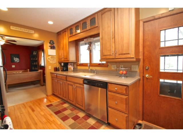 Updated kitchen has gleaming hardwood floors, stainless steel appliances and lots of storage.