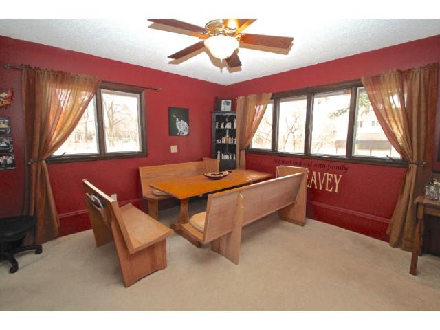 Generous sized dining area easily accommodates family & friends.