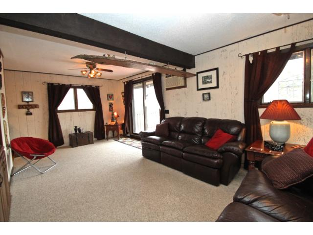 Main level family room with sliding glass door creates easy access for enjoying the spacious deck.