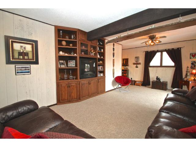 Main level family room has built ins, ceiling fan and plenty of room for your big screen tv.