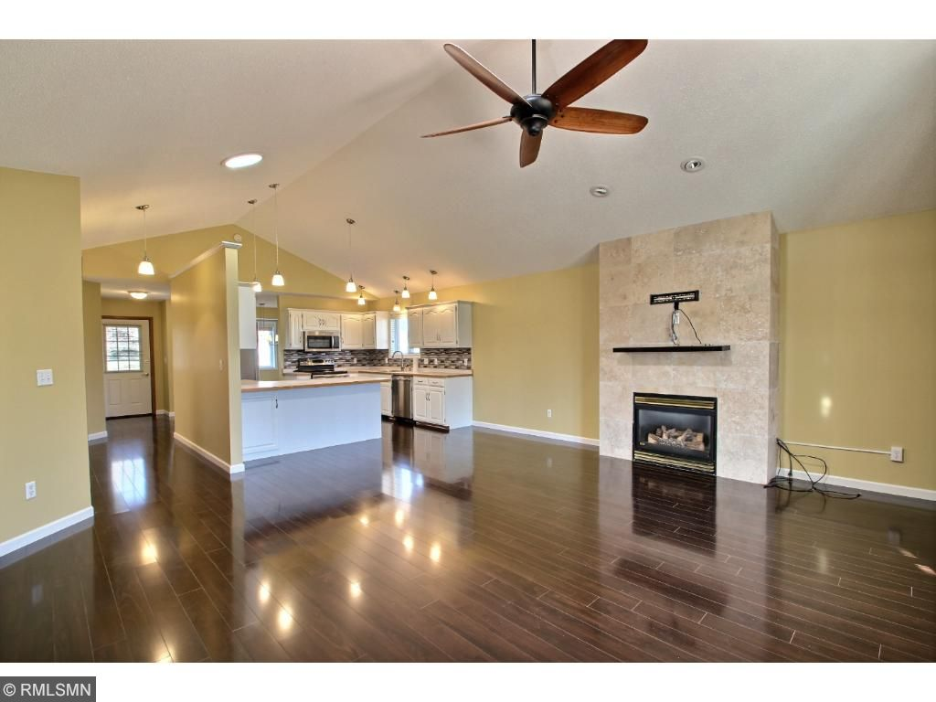 Warm up to a gas burning fireplace with nice tile accents. A large ceiling fan and can lighting finish off the space. The home is ideal for entertaining!