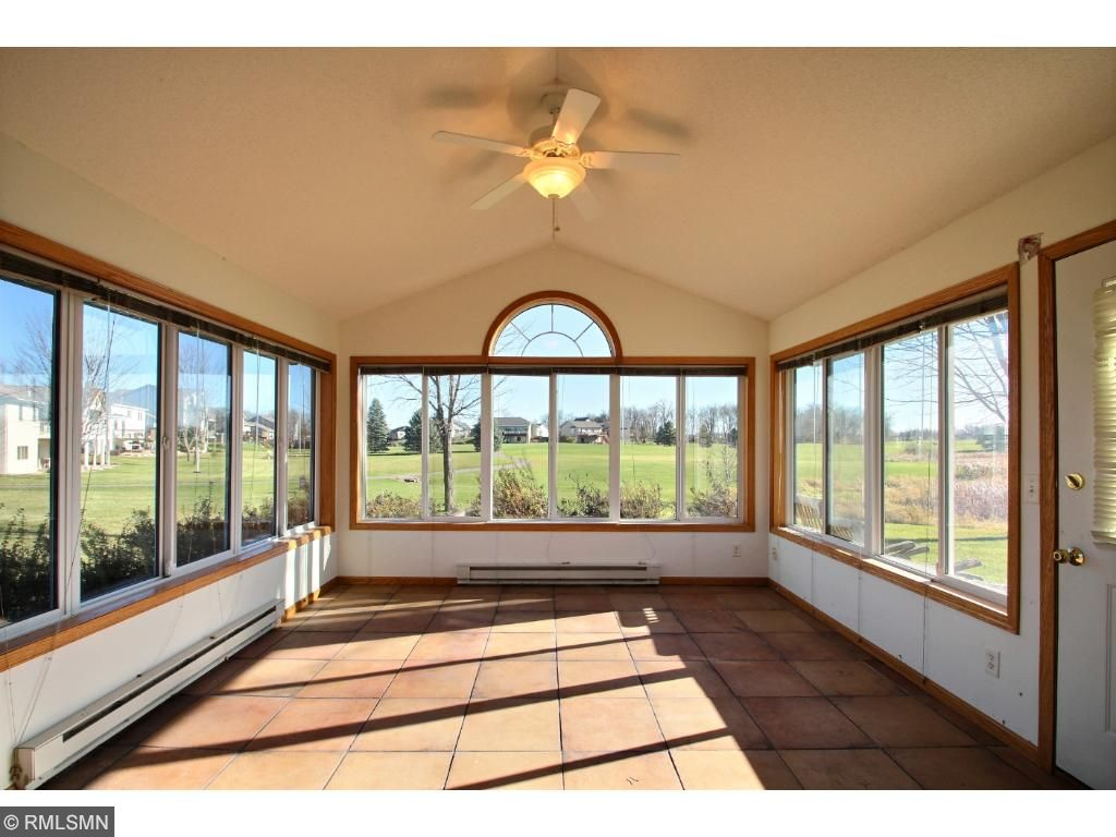 The porch also has nice tile floors and opens to the backyard patio with plenty of space to watch the golfers pass by or just to enjoy the gorgeous weather.