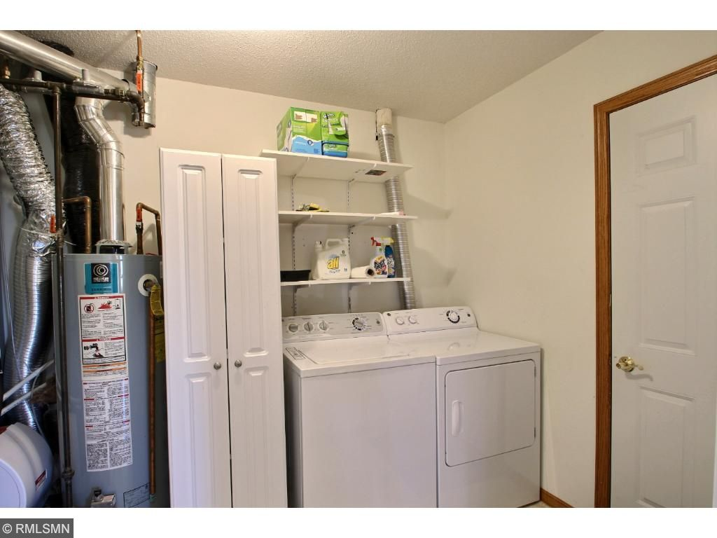 The laundry/utility room is a great space with a washer, dryer, water softener, cabinet and shelves. It opens to the large 24x20 garage with an opener.