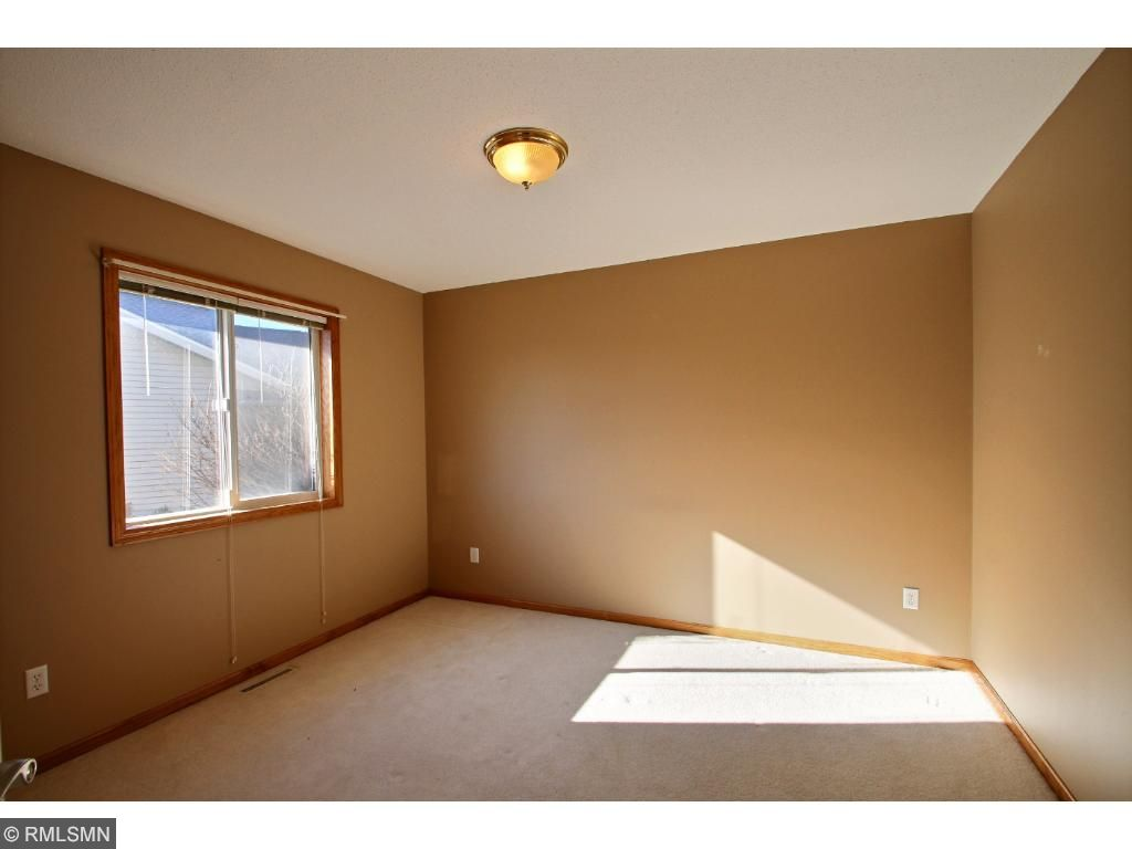 Just down the hall from the laundry room is the second bedroom, great for a kids room, office or guest room along with a full bathroom just steps away.