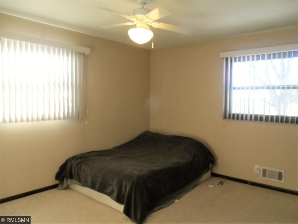 Master bedroom boasts lots of natural light from south and west facing windows...