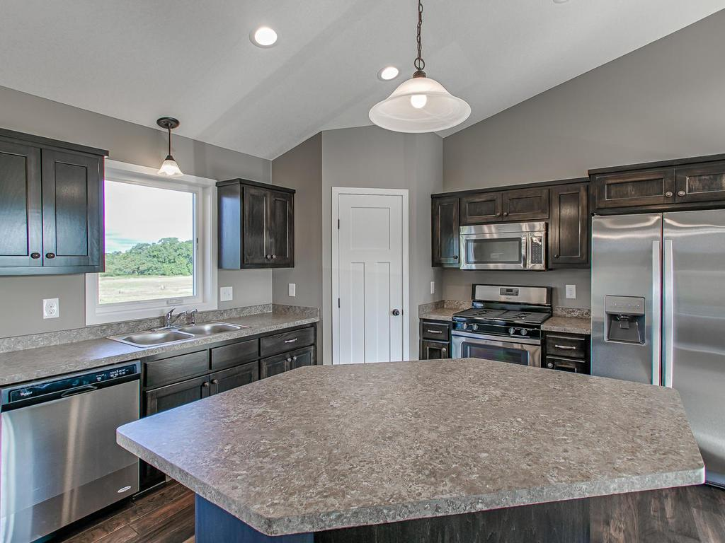 Fabulous center island and pantry for plenty of food storage.