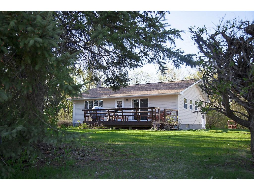 Incredible opportunity!  Excellent acreage - house is in good condition - well built - mature trees, outbuildings and more - an extremely valuable piece of real estate for future development!