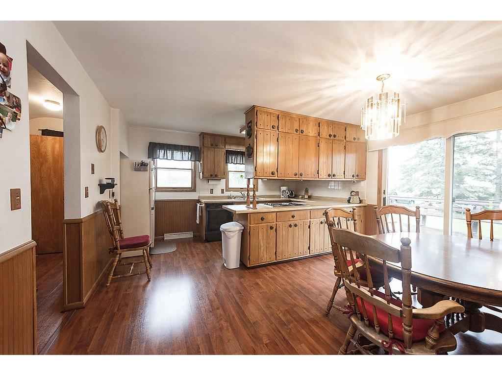 Check out the kitchen and dining area!  Beautiful floors, original woodwork, loads of cabinets - tons of windows and a great deck!