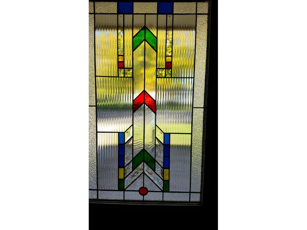 Beautiful stained glass door welcomes visitors.