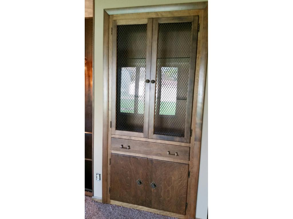 Built in cabinet with glass doors.