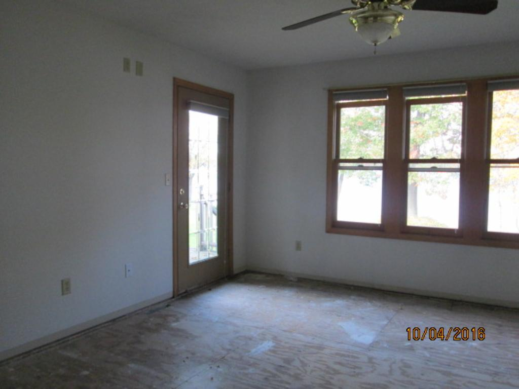 Master bedroom with lake view and door to deck and rear yard