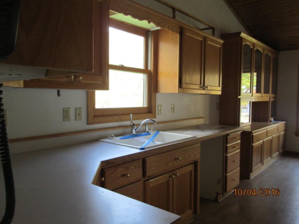 Custom oak kitchen with raised panel doors.