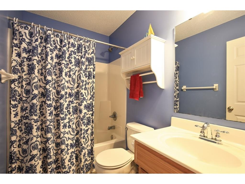 Enjoy dual sinks in MBA, separate shower and whirlpool tub with access to walk-in closet with built-ins.