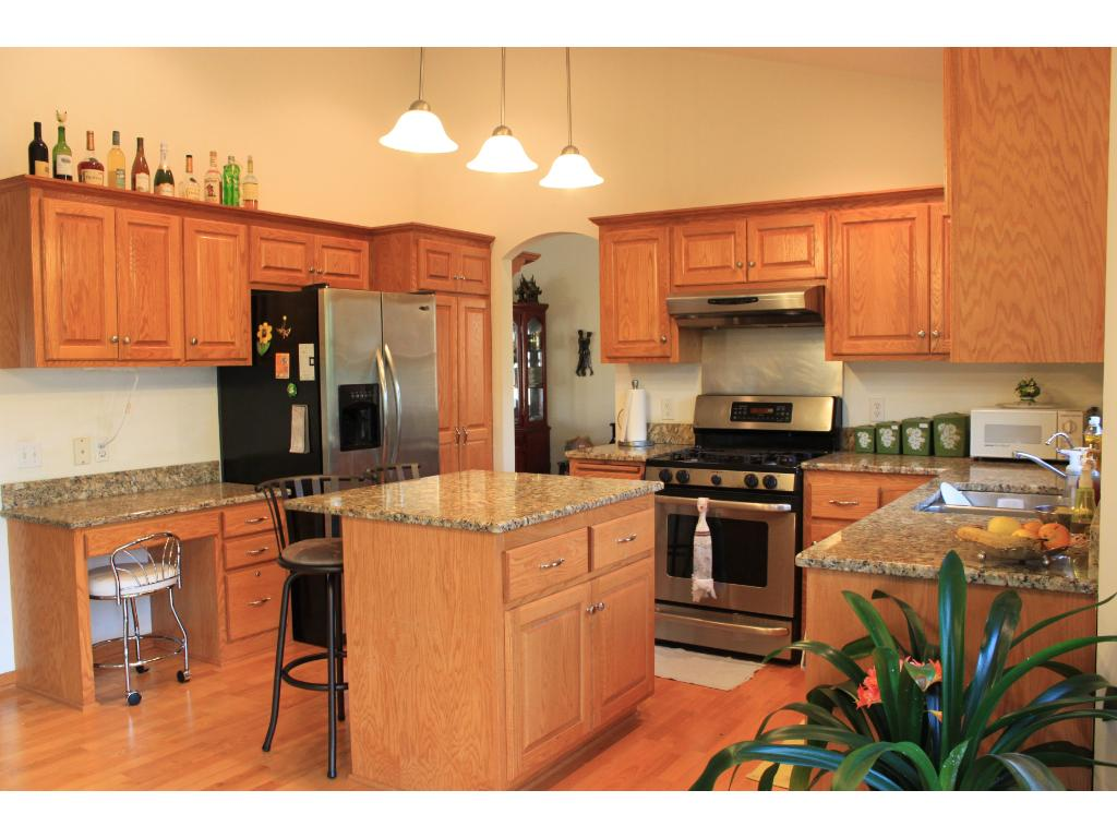 spacious kitchen with granite countertops