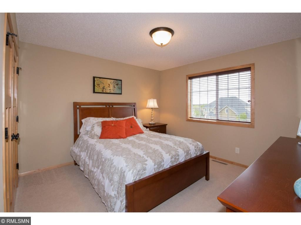 Large front bedroom with large windows and nicely-sized closet.  Two panel wood doors and neutral decor.  Located off laundry near hall bath.