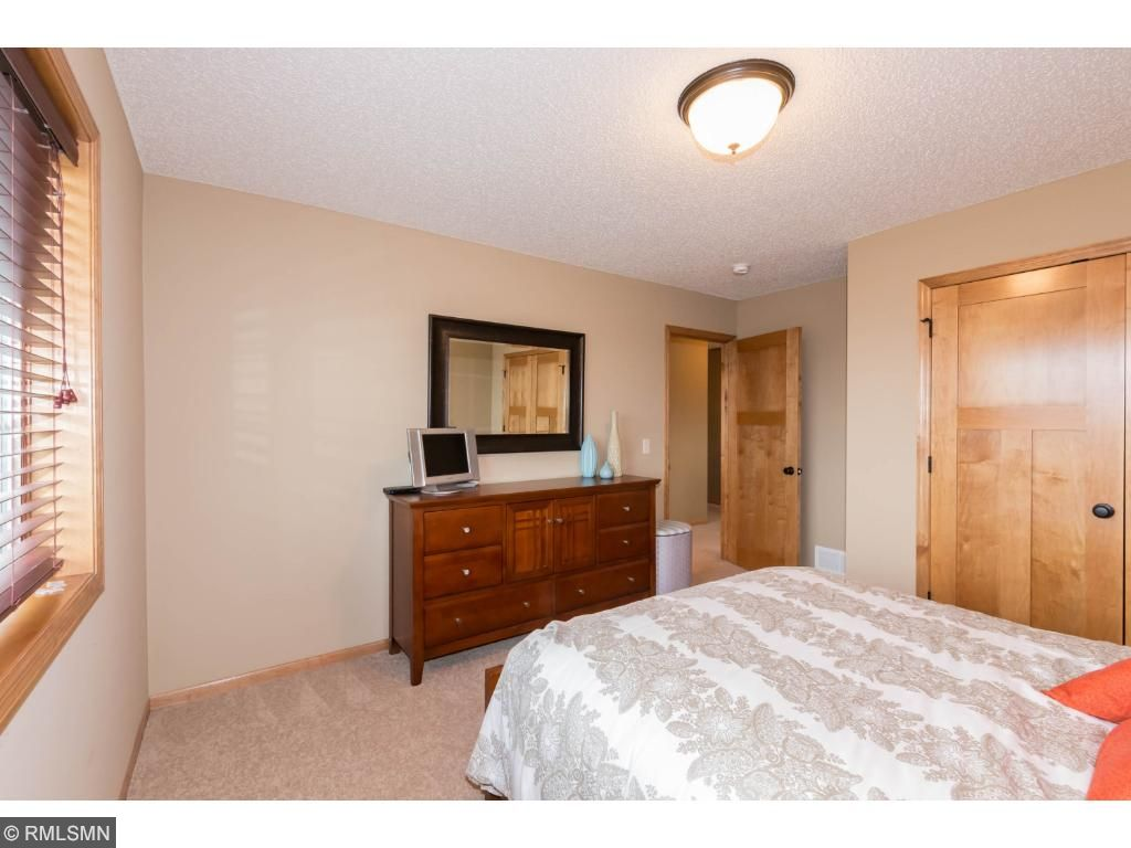Front-facing bedroom with large closet.  View of wood closet door opens to large storage space.