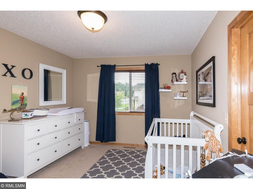 Side-facing bedroom with lots of space and large windows.  Located down the hall for quiet and privacy.
