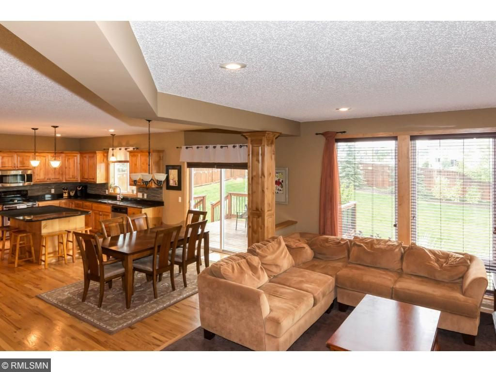Great rooms opens to informal dining area.  Dining area part of the open floor plan across the entire back of the home. Wood floors in the dining area with bronze-finished fixture.  Opens to kitchen which is very convenient.  Plenty of space.