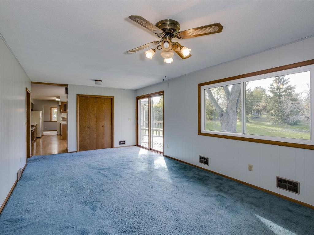 Family room with slider to large deck