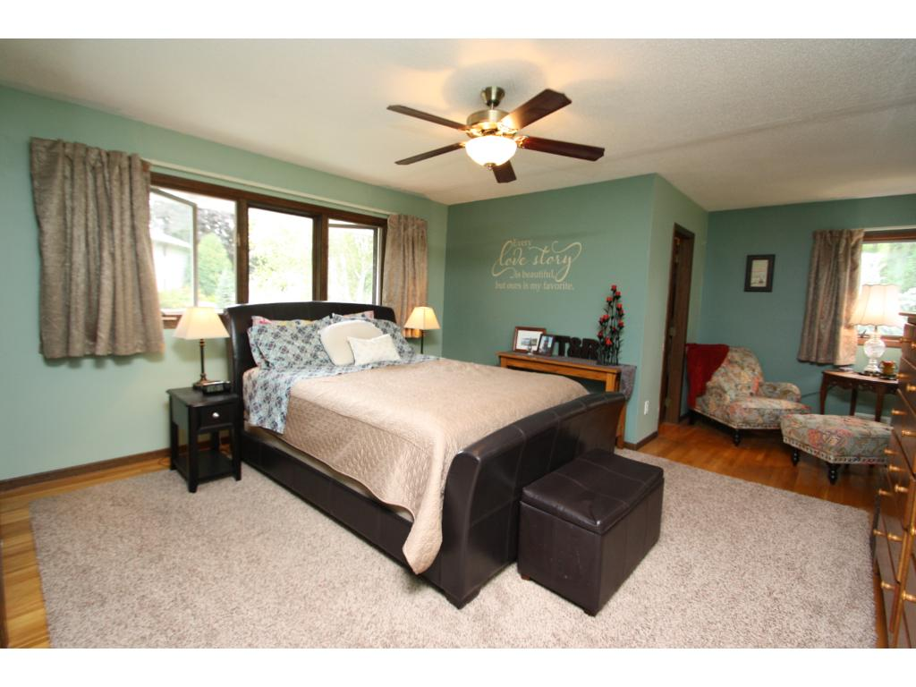 Master bedroom suite complete with remodeled bathroom, walk-in closet and seating area.