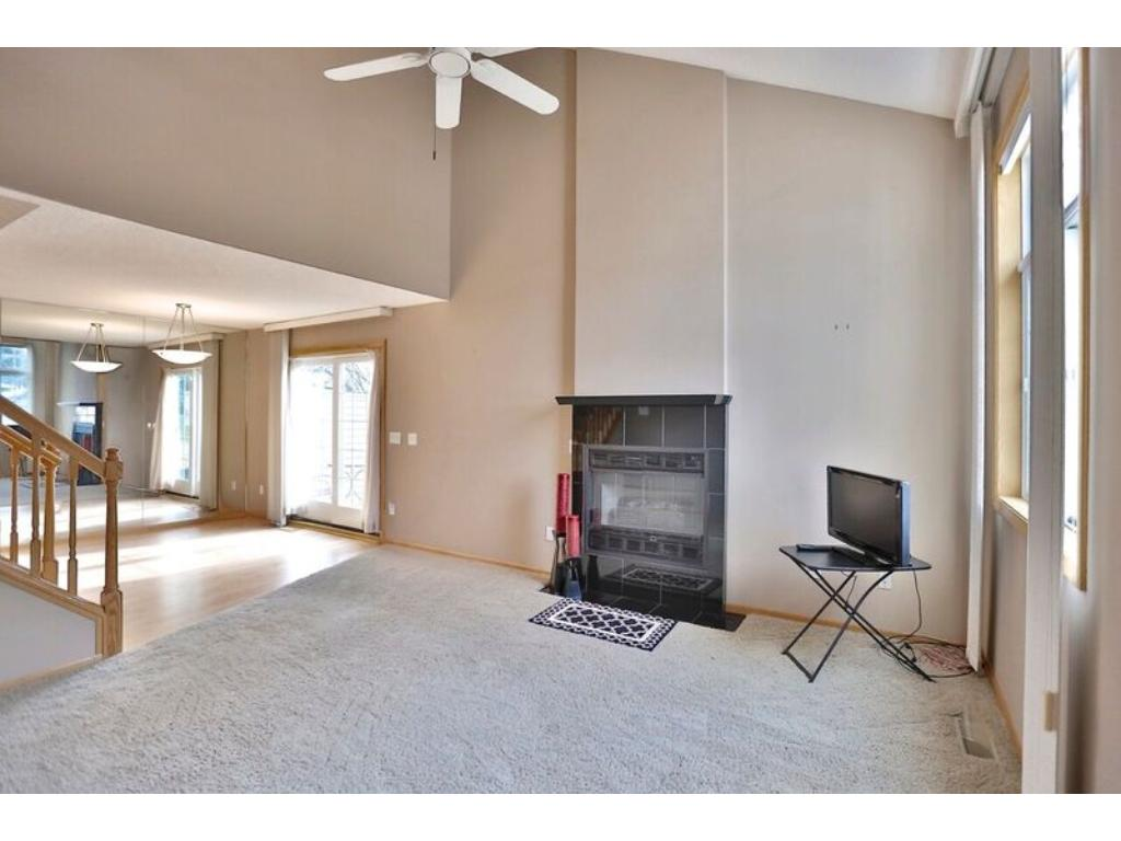 Vaulted ceilings in living room with fireplace.