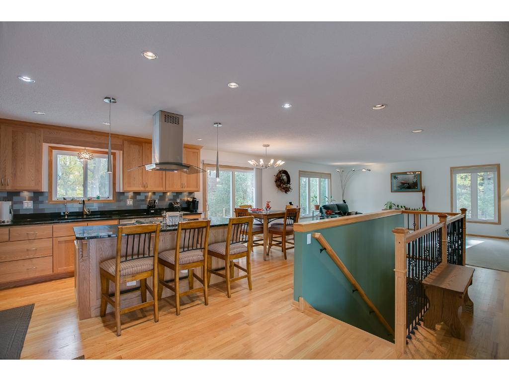 Beautiful, large kitchen with stainless steel appliances and center island is a chef's dream!