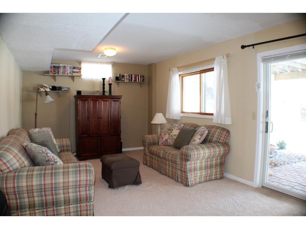 You are sure to love this large laundry room with tons of storage cabinets and counter space to fold.