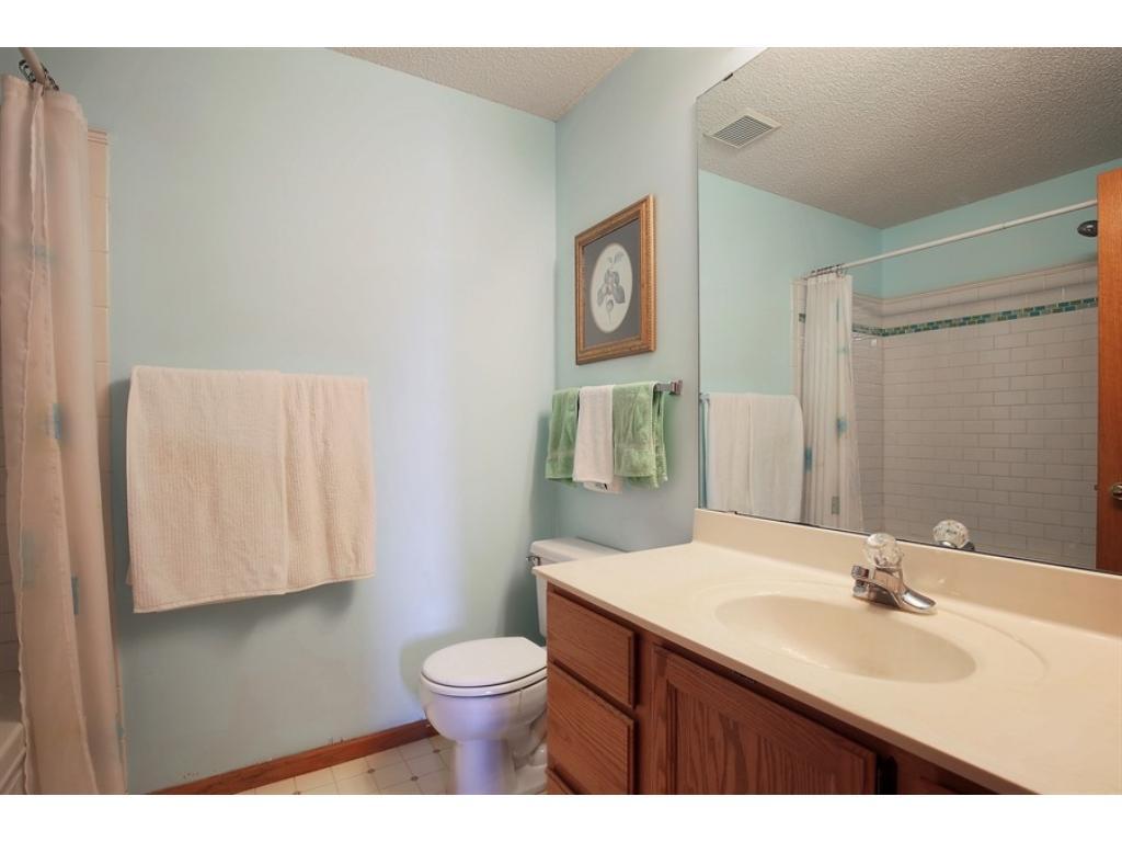 Full bath upstairs with deep soaking tub and ceramic surround.