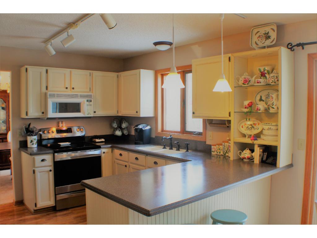 On-Trend kitchen cabinets, new SS range, oak floors.