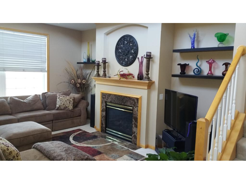 A flip of a switch with this gas fireplace warms this great space on a cool Minnesota evening