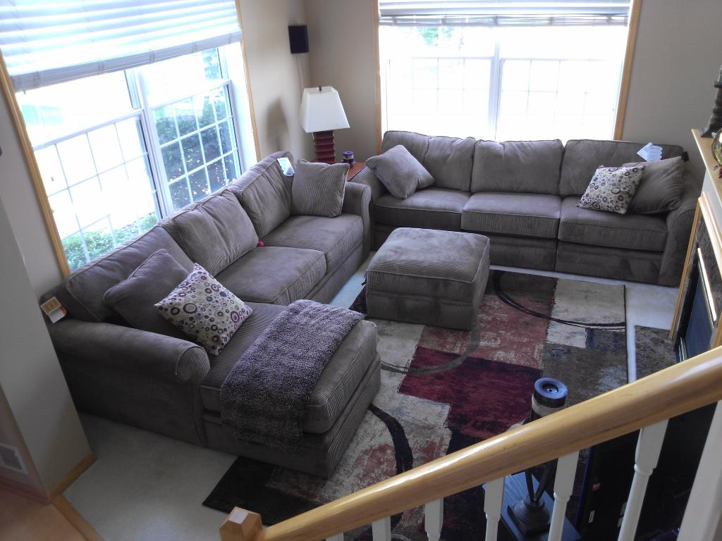 Great living room with lots of natural light from large windows and open to upper level loft and gas fireplace - must see to appreciate