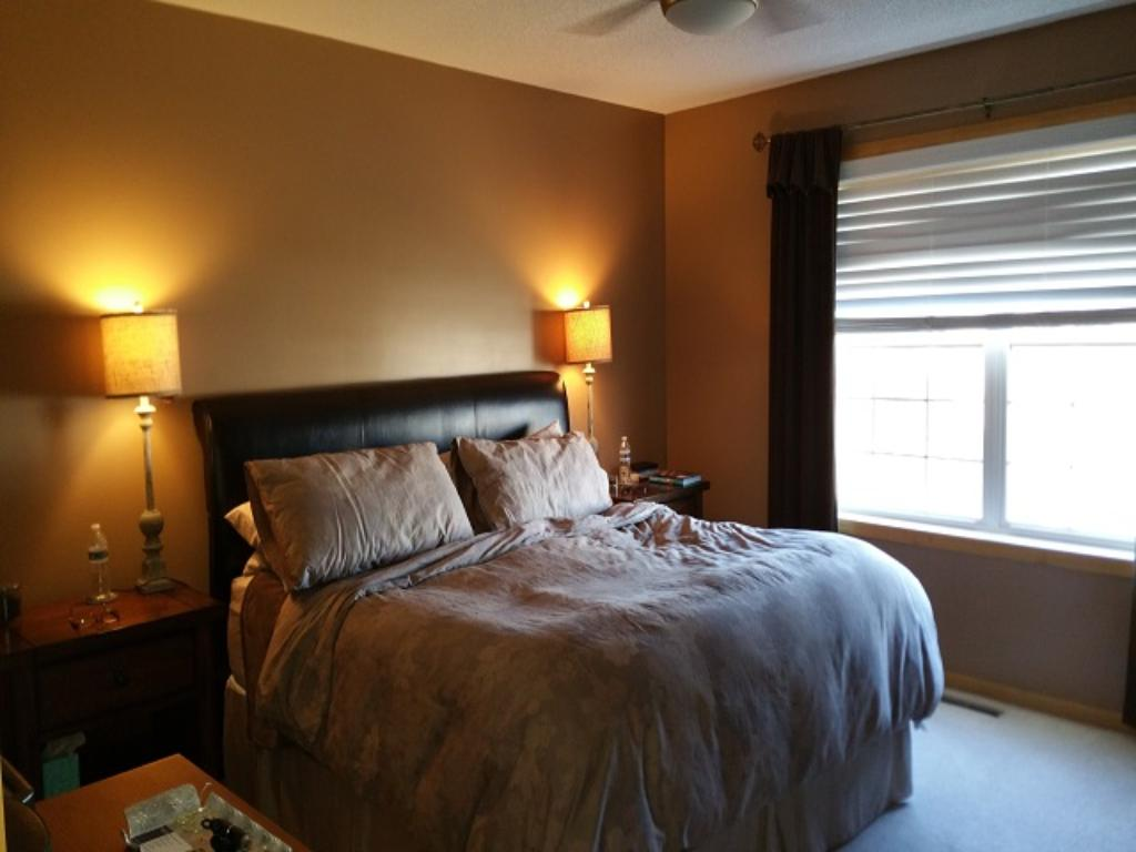 Large master bedroom with two large closets and private master bathroom