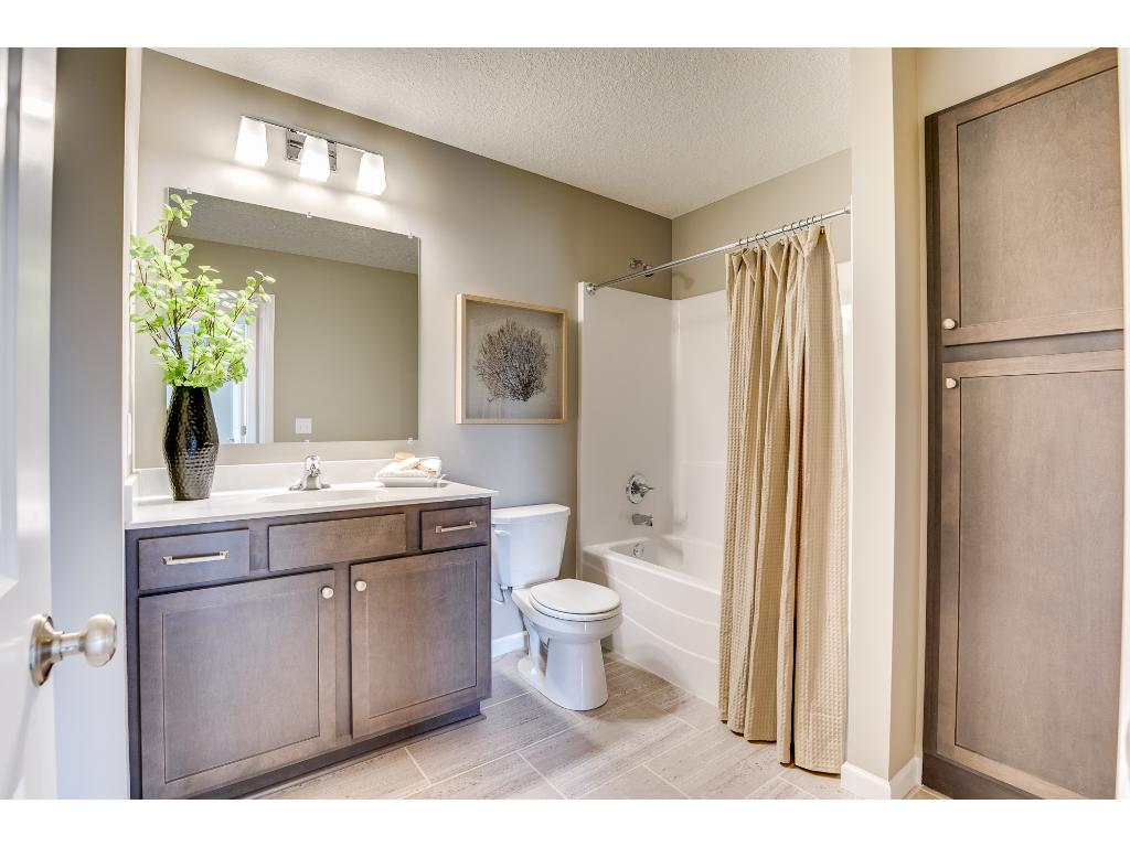 ... vary. Lower level full bath with a linen cabinet for extra storage